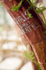 As a special surprise for Katie and Chris, her father commissioned an artist friend to engrave the couple's initials and a love note into copper panels that were soldered into each tree.