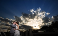 Newlywed bliss against an ethereal sky on the Weaver Terrace.