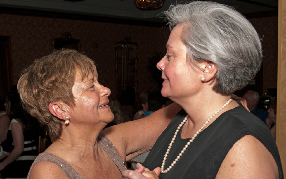 "The first dance, with Madeline (left) and JoAnna (right) swaying to ""Time after Time,"" sung by Rod Stewart."